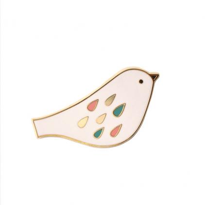 Pin's oiseau poudre